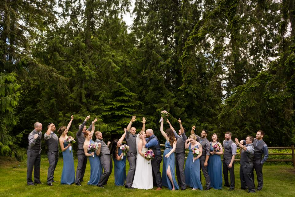 wedding party cheering on bride and groom salt and pine
