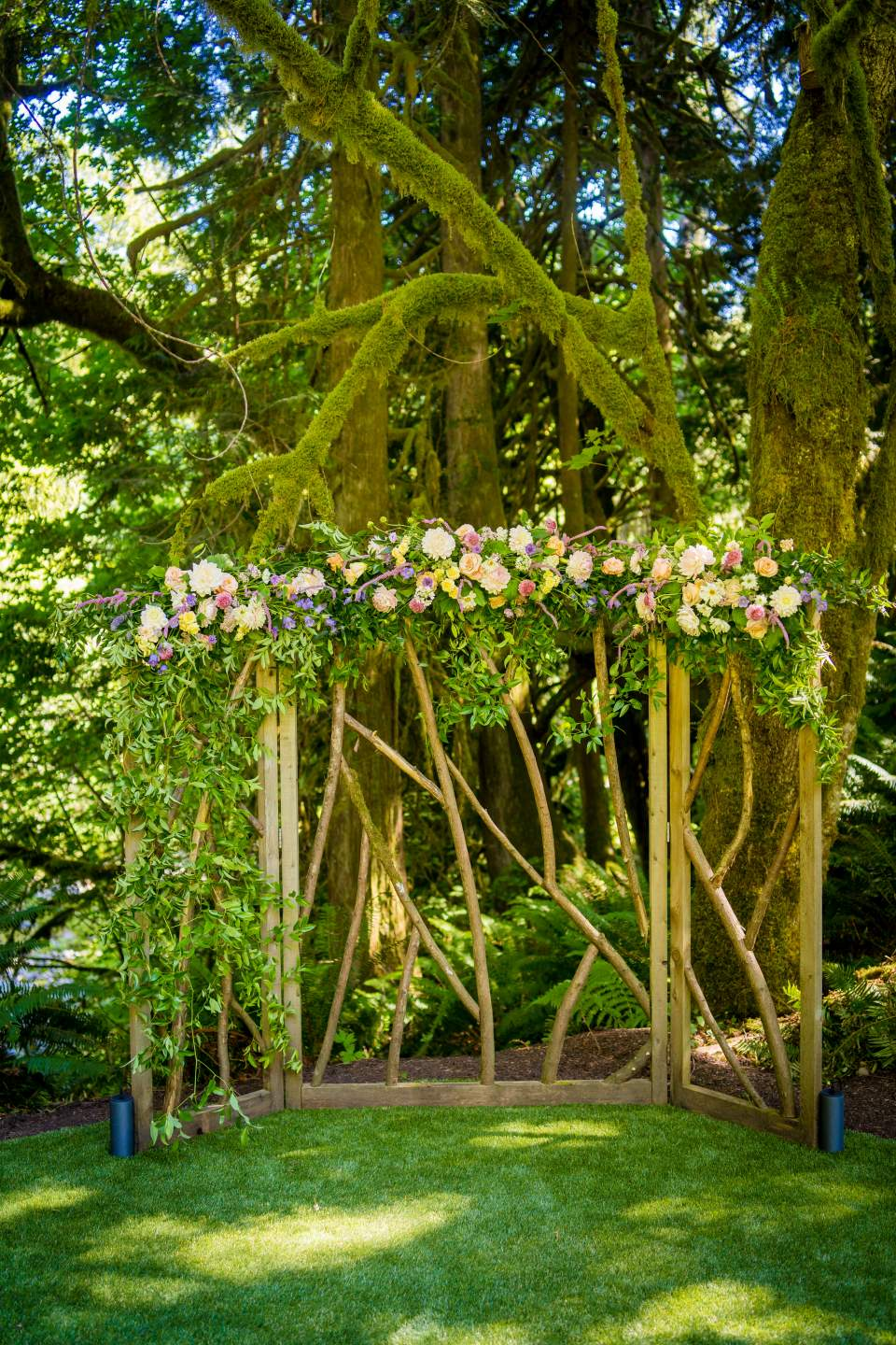 arbor decorated for wedding ceremony at tree house point
