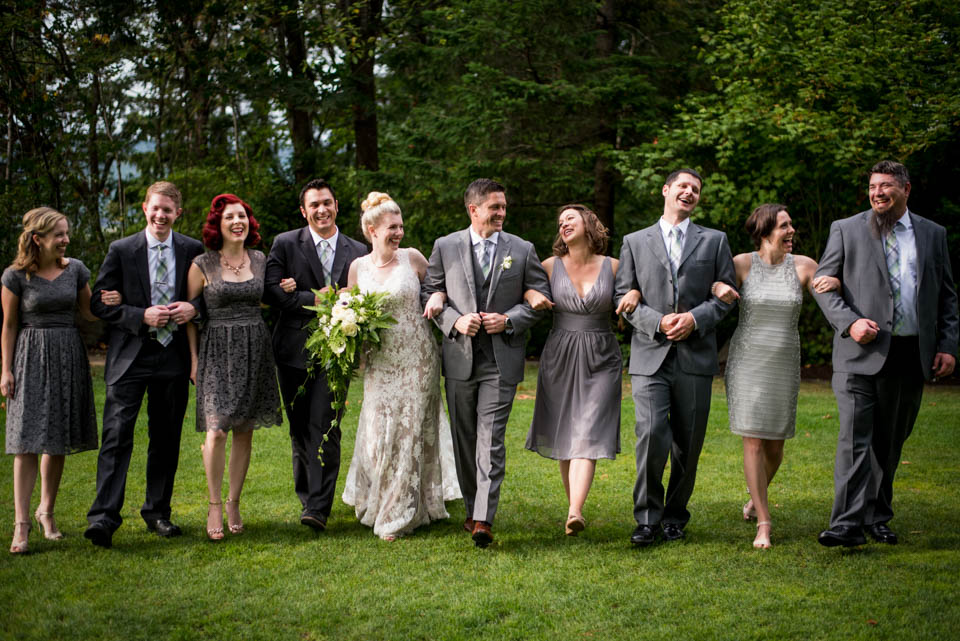 bridal party walking arm in arm fun photos