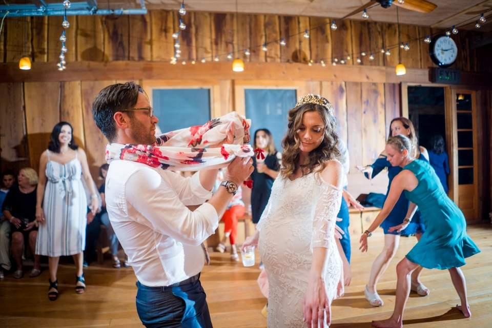 bride and groom breaking it down on the dance floor
