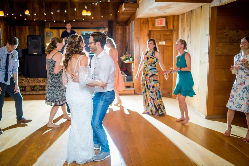 bride and groom dance to one last song on wedding day