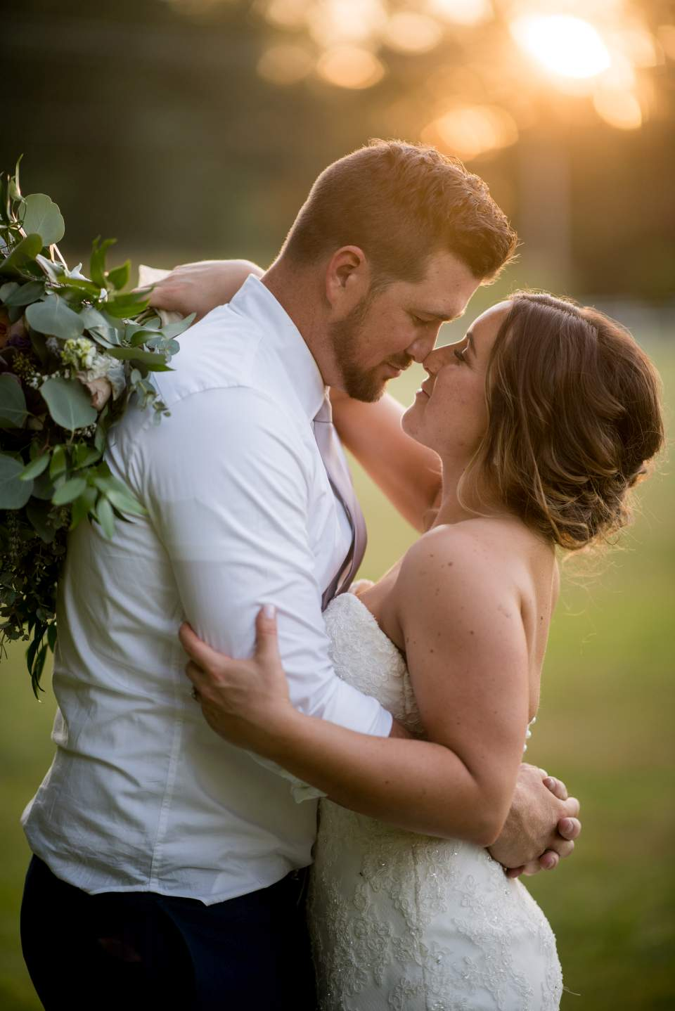 bride and groom embrace at sunset maplehurst farm wedding
