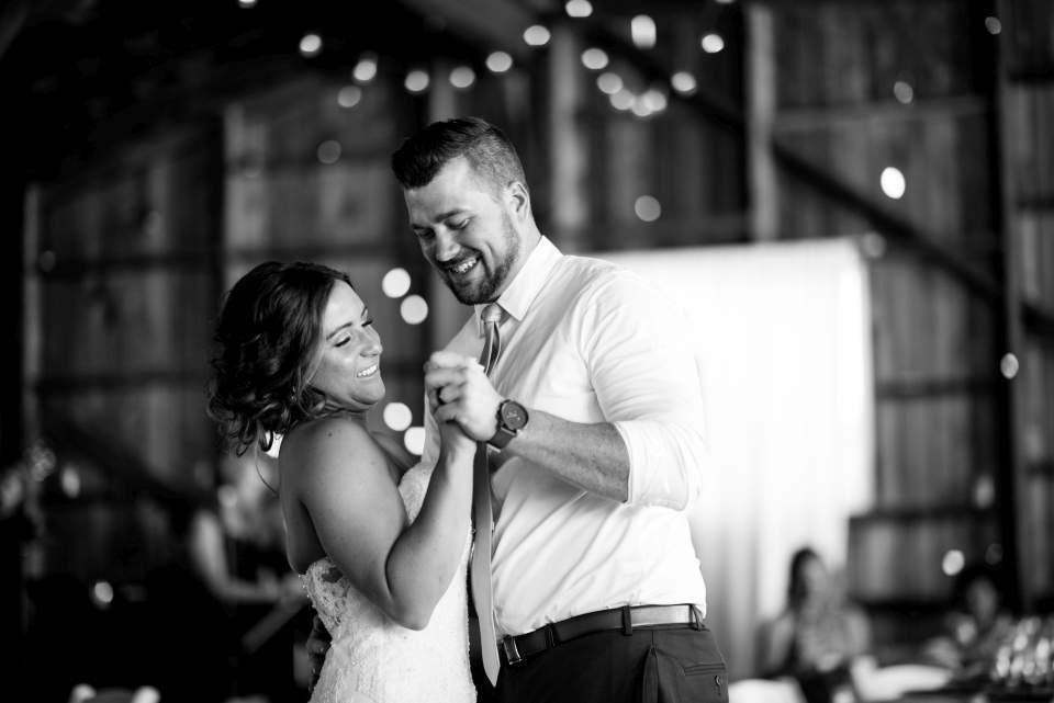 bride and groom first dance barn wedding