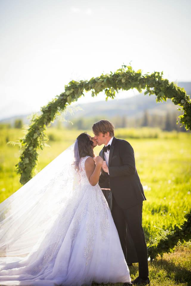 bride and groom first kiss grand teton