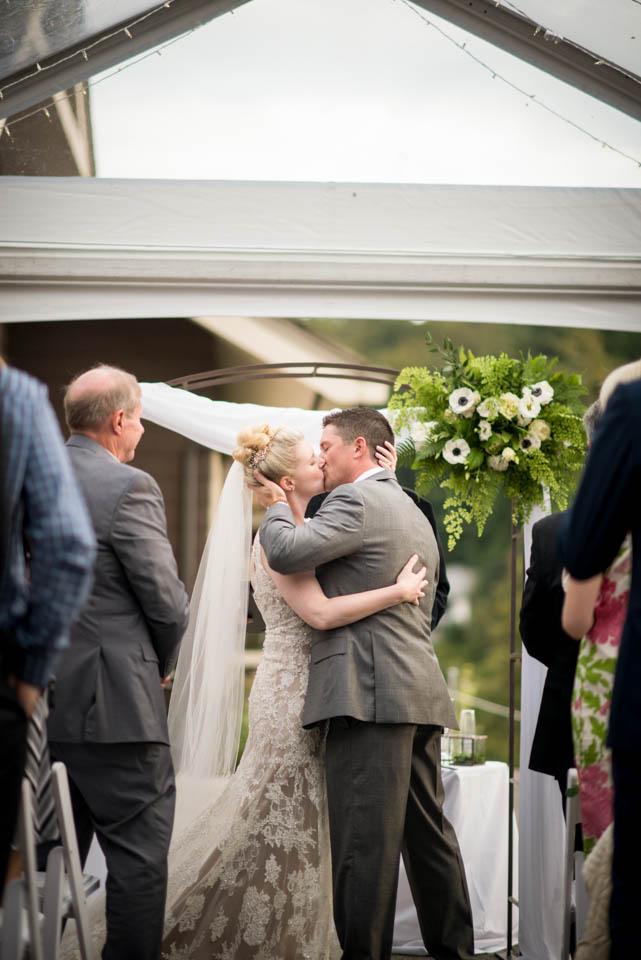 bride and groom first kiss seattle wedding photographers salish lodge ceremony