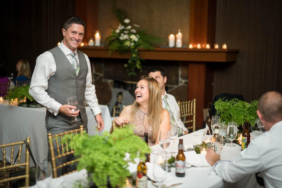 bride and groom having fun wedding reception photos