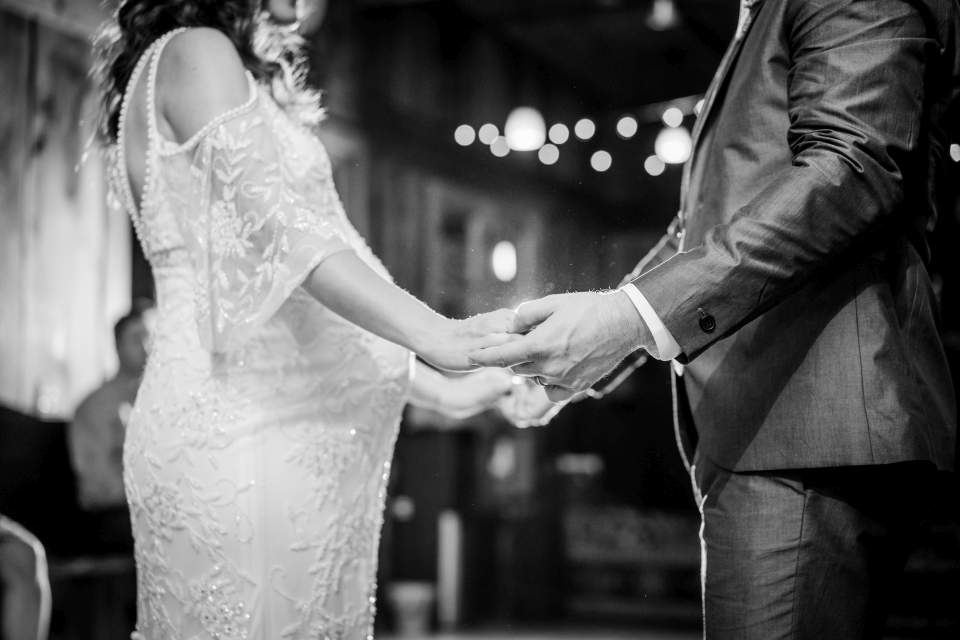 bride and groom holding hands on dance floor