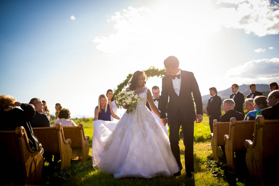 bride and groom walking down the isle together