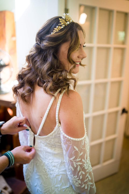 bride puts wedding dress on