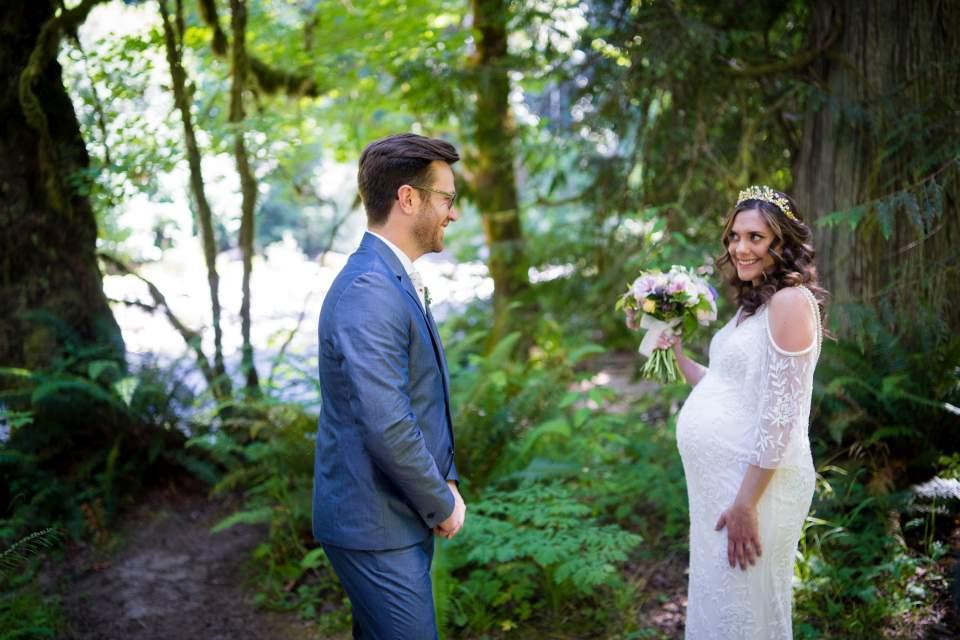 bride showing off boho wedding dress
