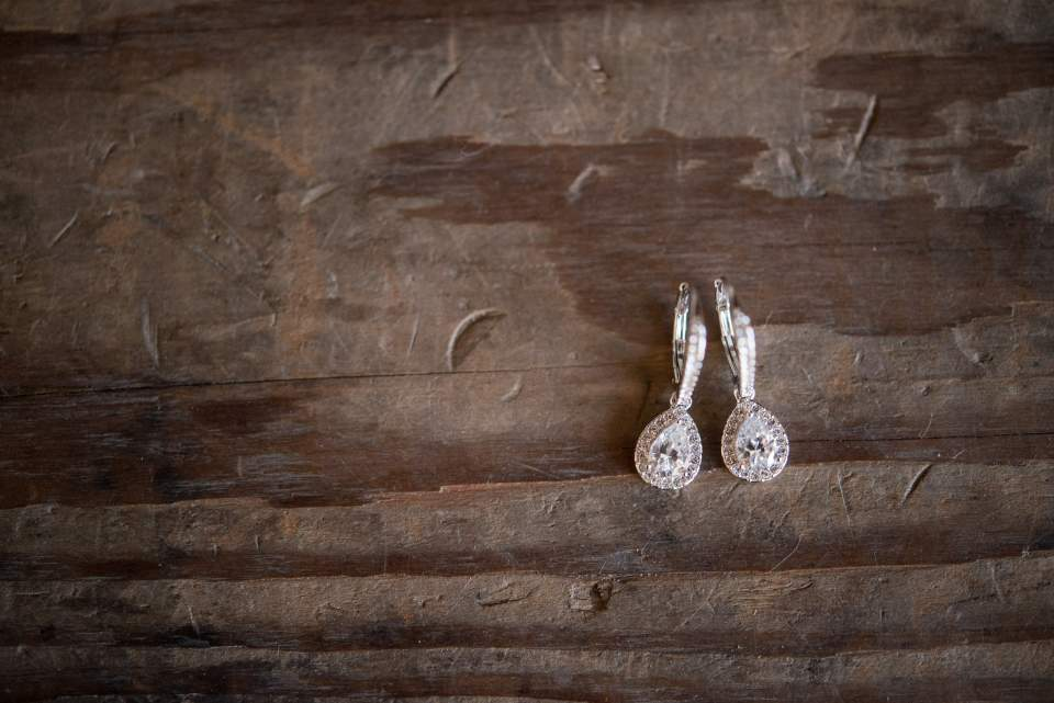 brides jewelry photographed on old wood