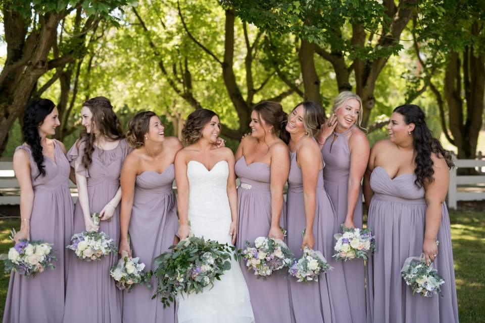 bridesmaids having fun together on wedding day