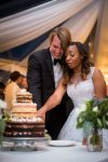 couple cutting the cake wedding reception