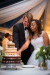couple cutting the cake wedding reception