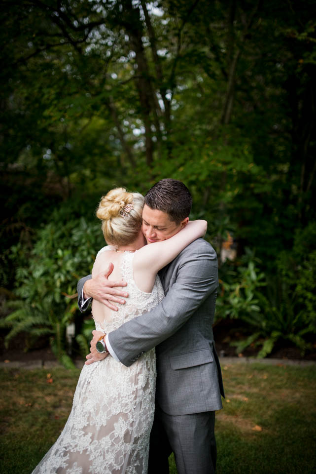 couple embracing after first look
