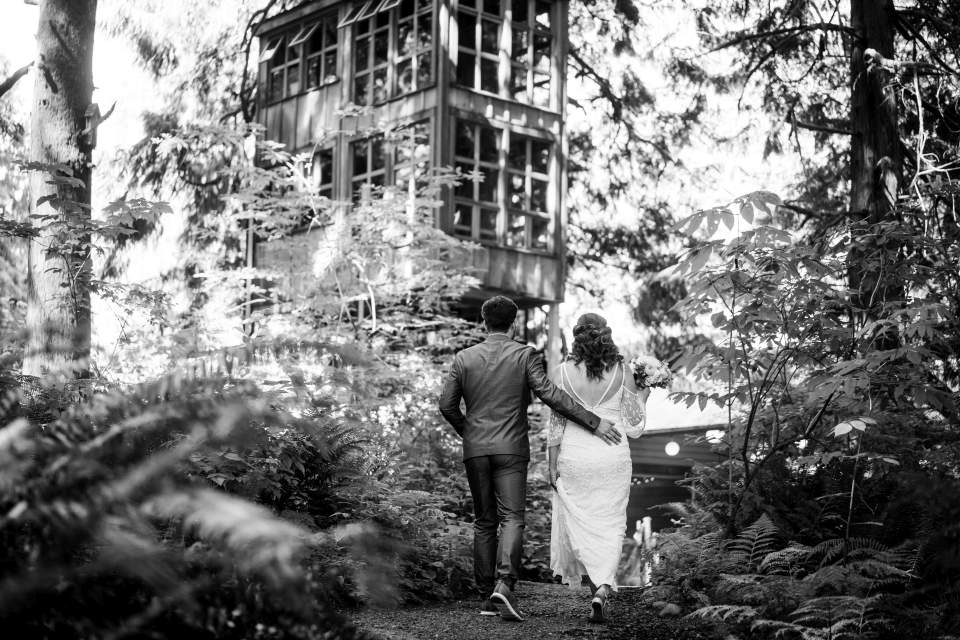 couple walking under treehouses