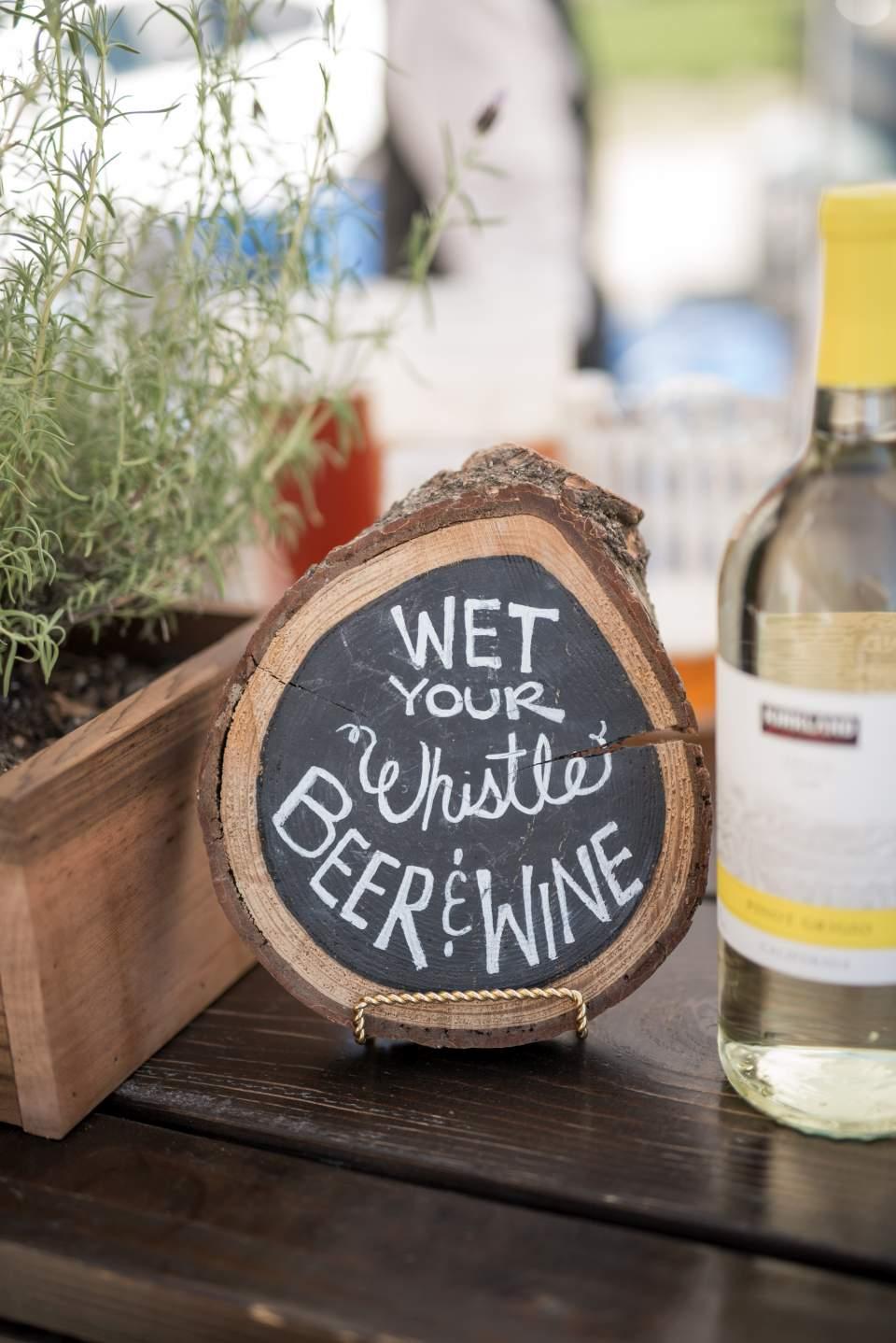cute bar sign at wedding