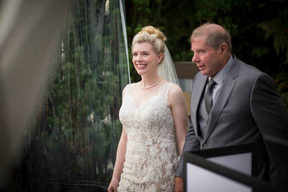 father and brid walking down the isle