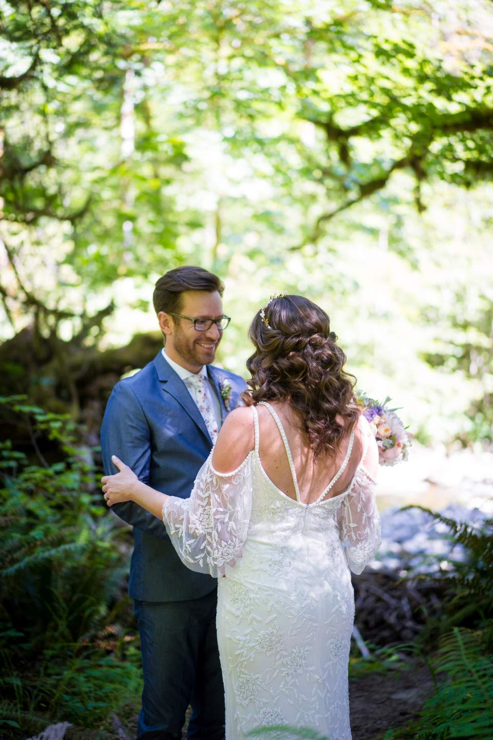 first look in woods at treehouse point wedding