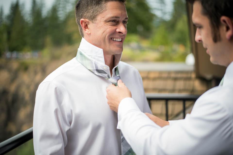 groom getting ready with best man wedding day
