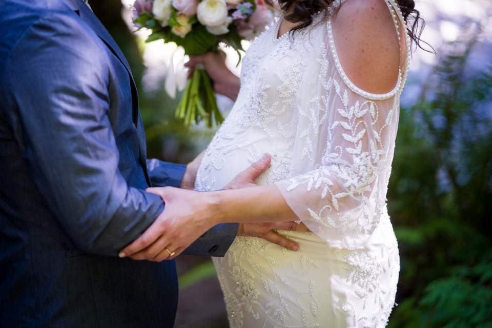 groom holding bride in loving embrace