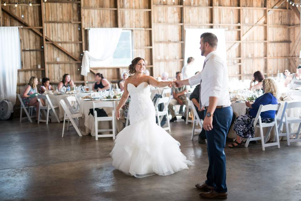 groom leads bride onto dance floor
