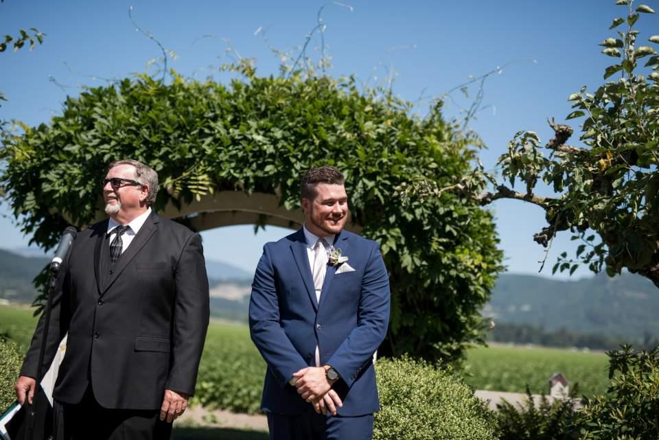 groom reacting to seeing bride walk down aisle
