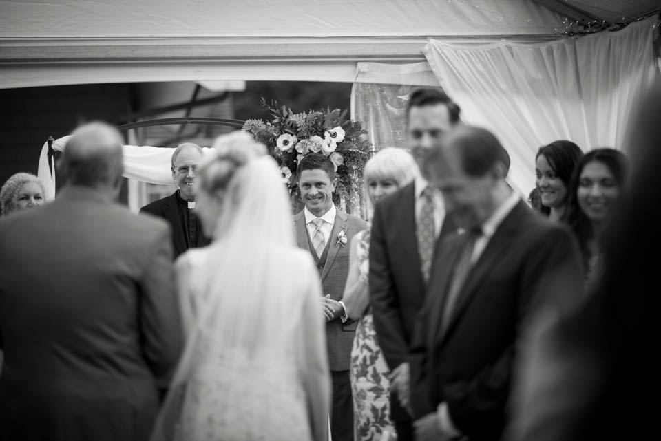 groom seeing bride first time walking down the isle