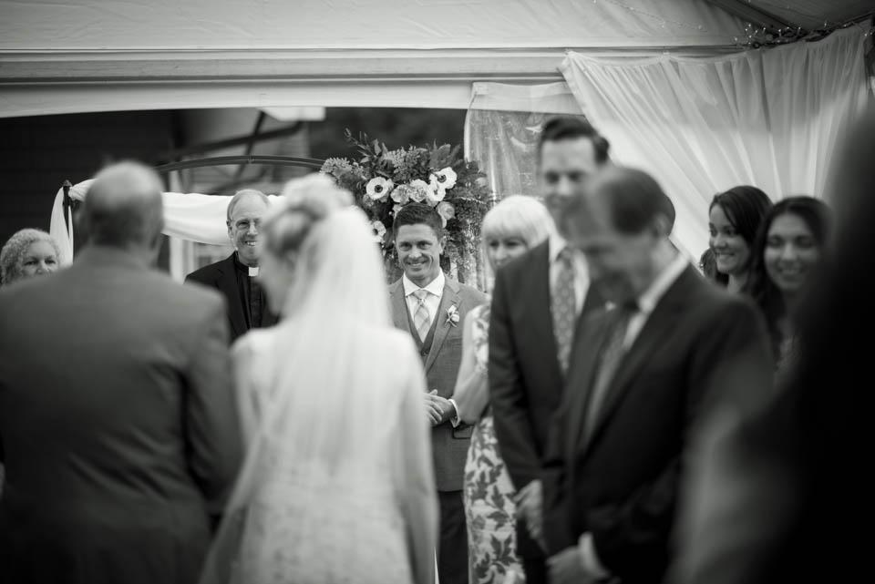 groom seeing bride first time walking down the isle