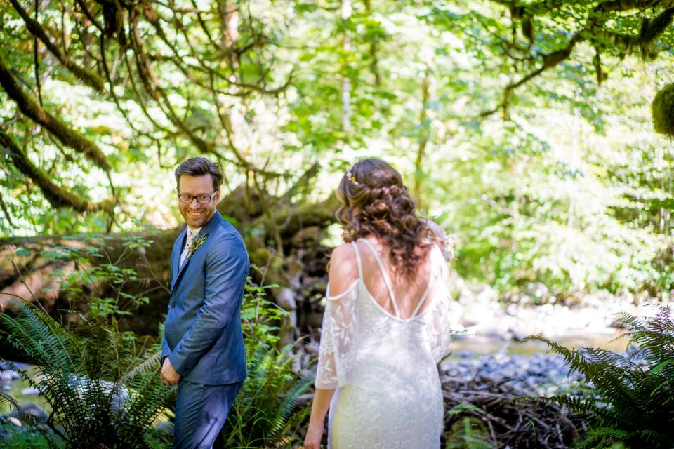 groom turns around to see bride for first time on wedding day