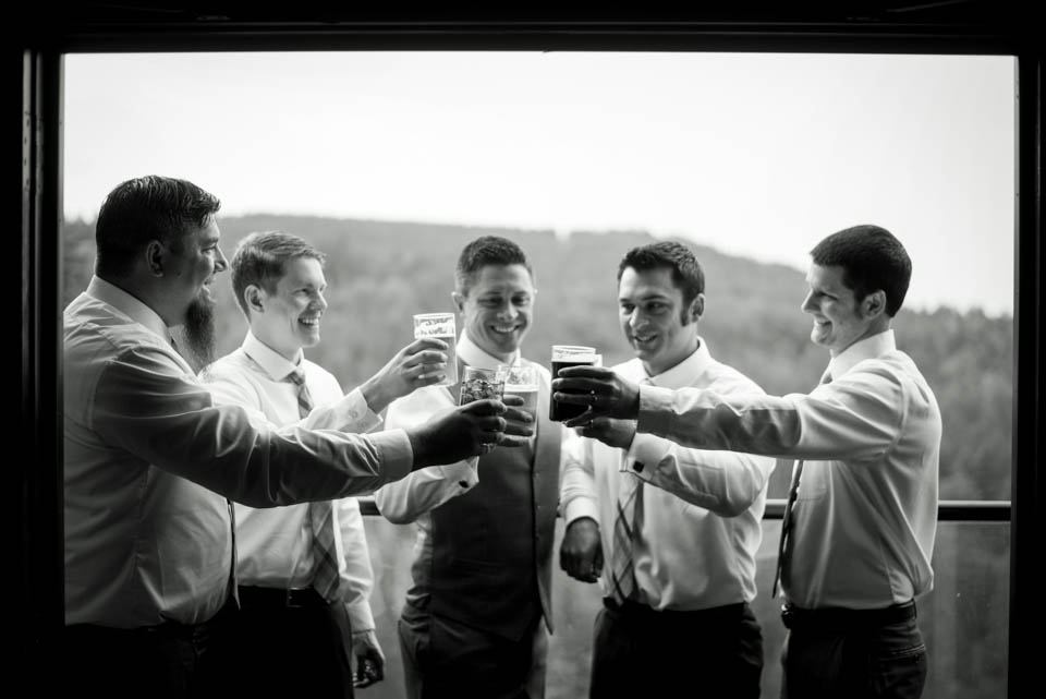 groomsmen having sharing a toast hanging out