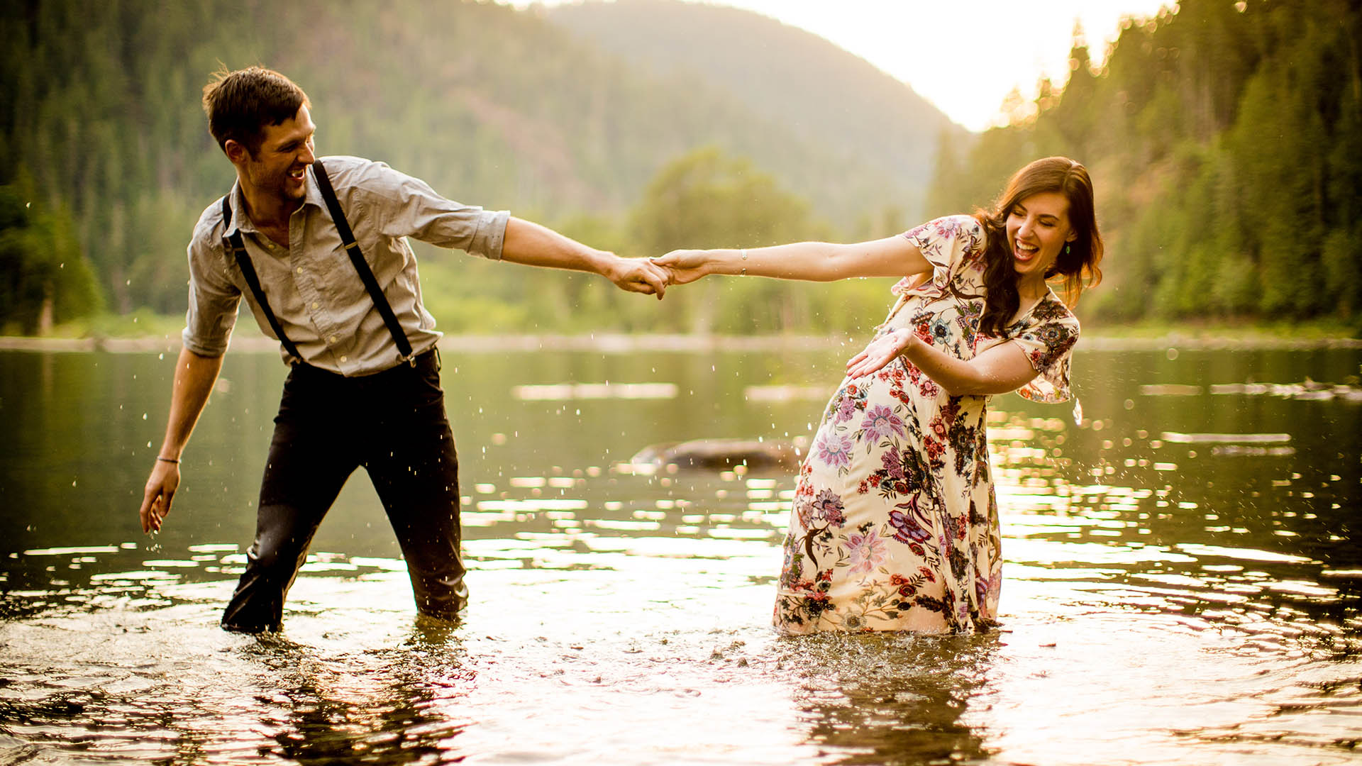 adventurous couple gets in lake cushman for engagement photos 1