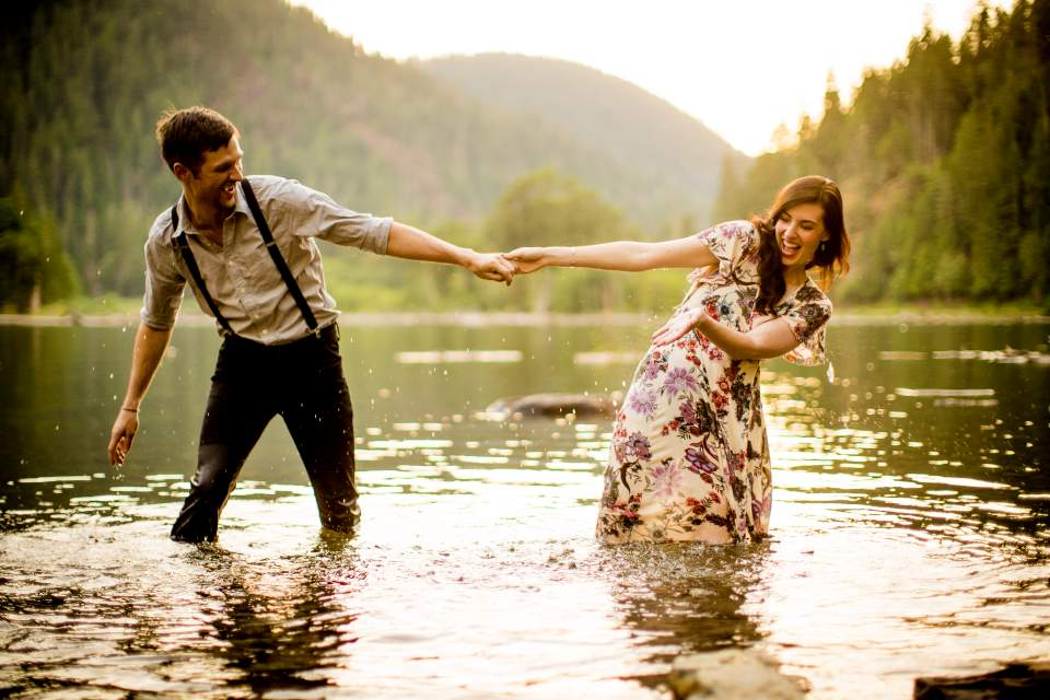adventurous couple gets in lake cushman for engagement photos