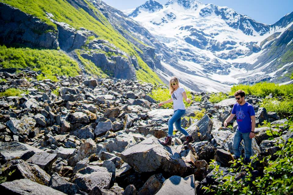 couple adventuring at byron glacier