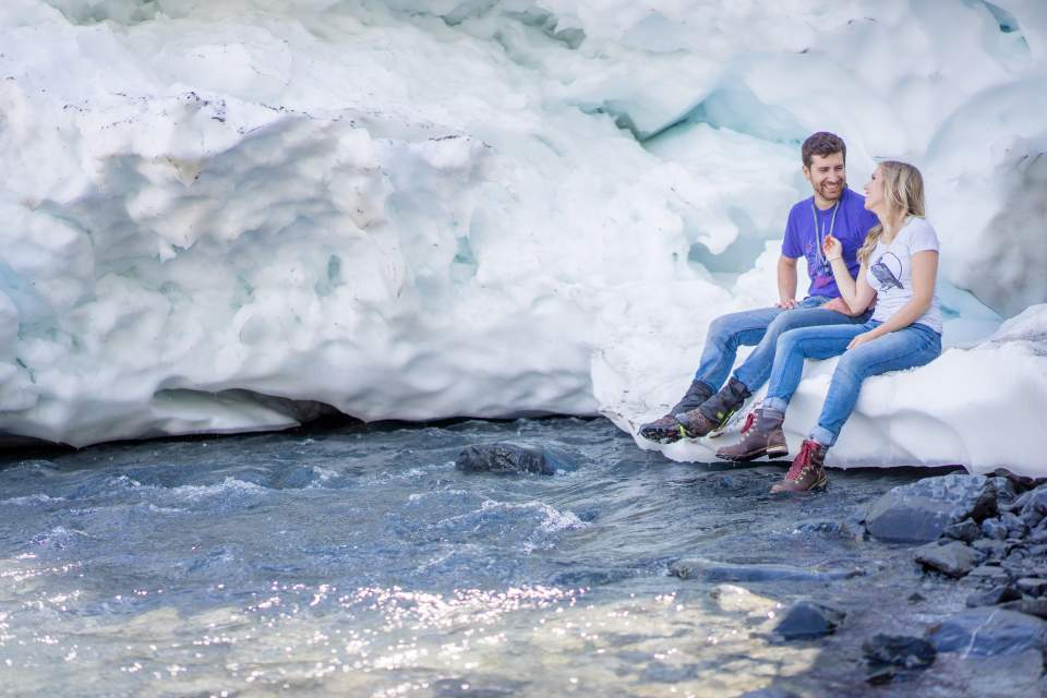 couple chilling out on a glacier in alaska