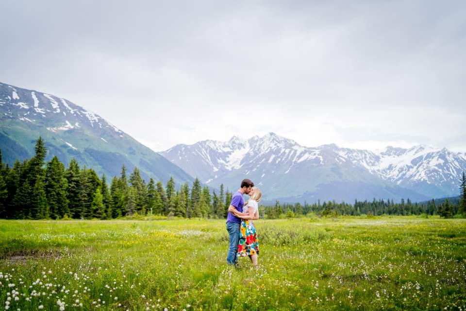 couple kissing in moose meadows girdwood alaska