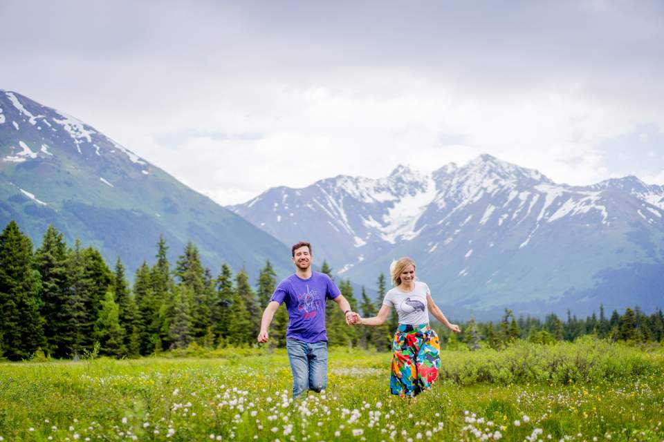 couple walking through flowers in girdwood