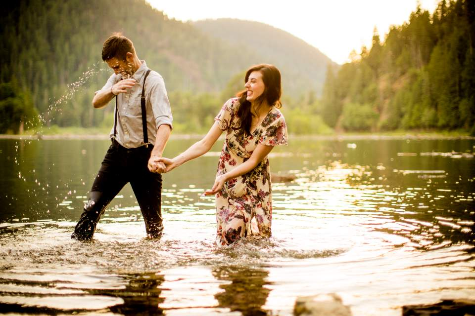 splash fight in the lake during engagement photos