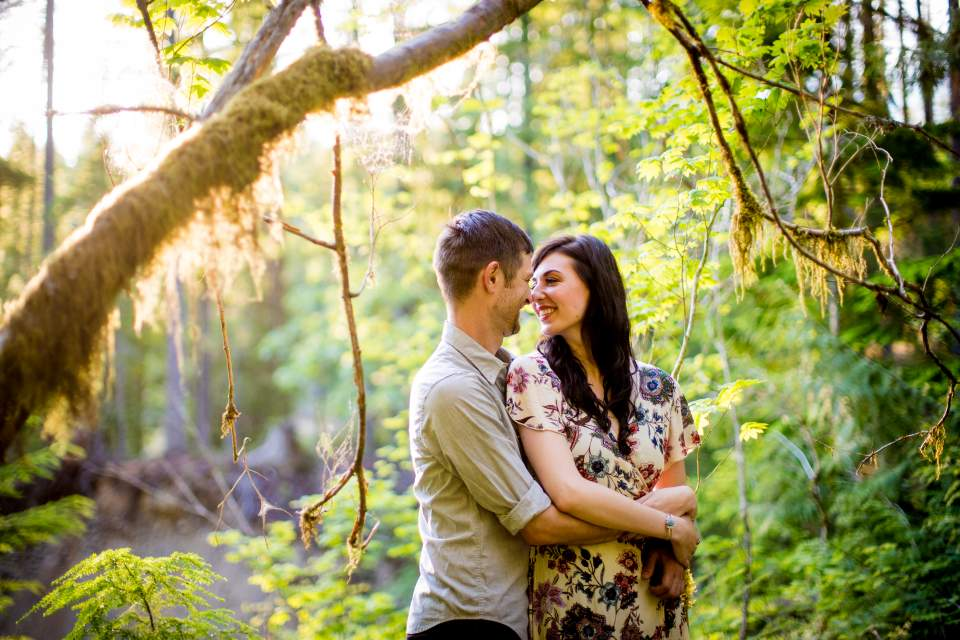 sunny engagement photos in the woods at lake cushman