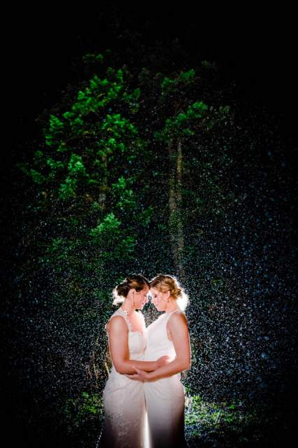 adventurous brides embrace in rain 2
