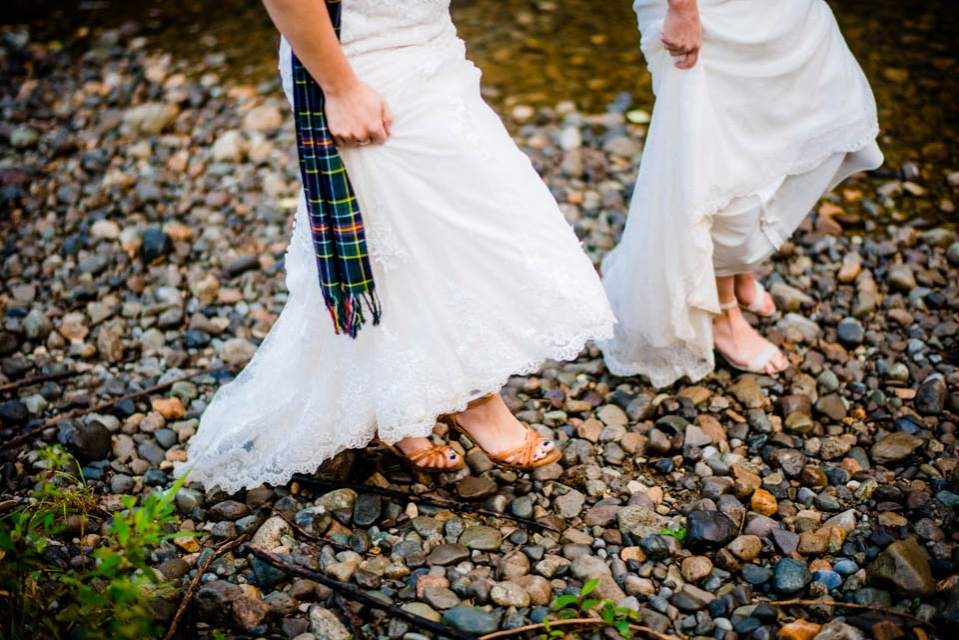 adventurous brides walking next to river 2