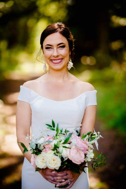 beautiful bride holding bouquet of soft pink flowers