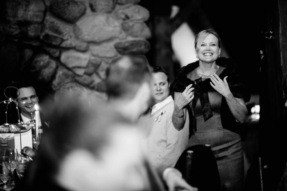black and white photo of mother of groom giving toast