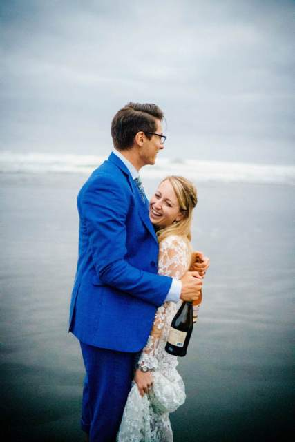 bride and groom celebrate with champagne