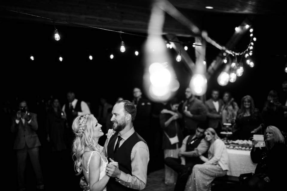 bride and groom dancing under the lights