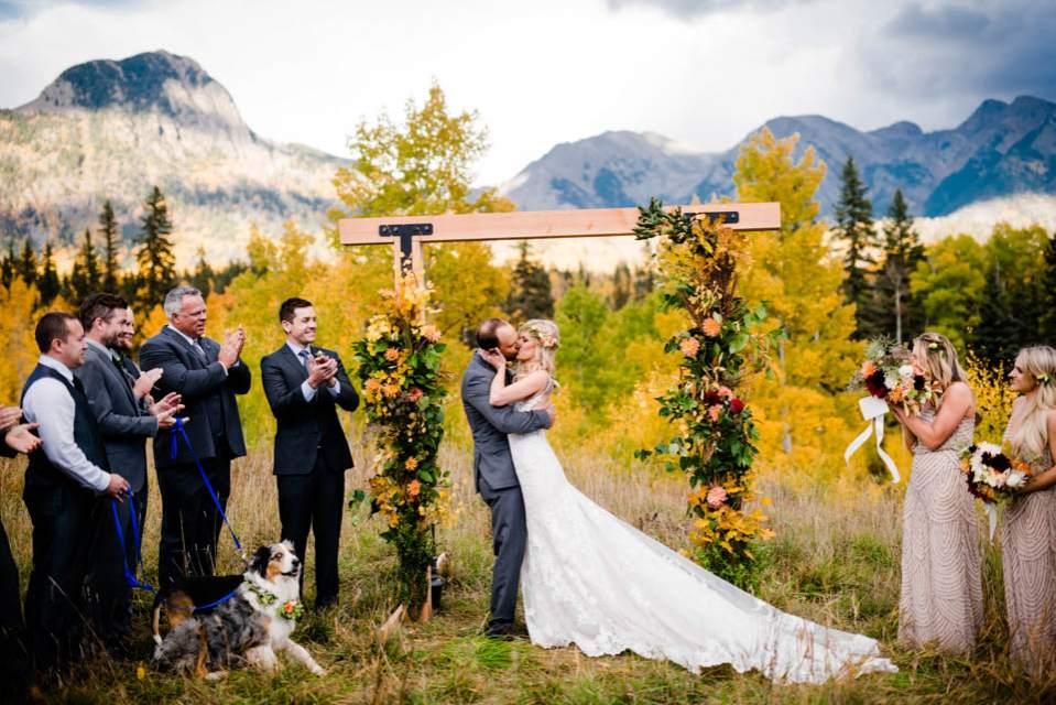 bride and groom get married in colorado mountains peak fall
