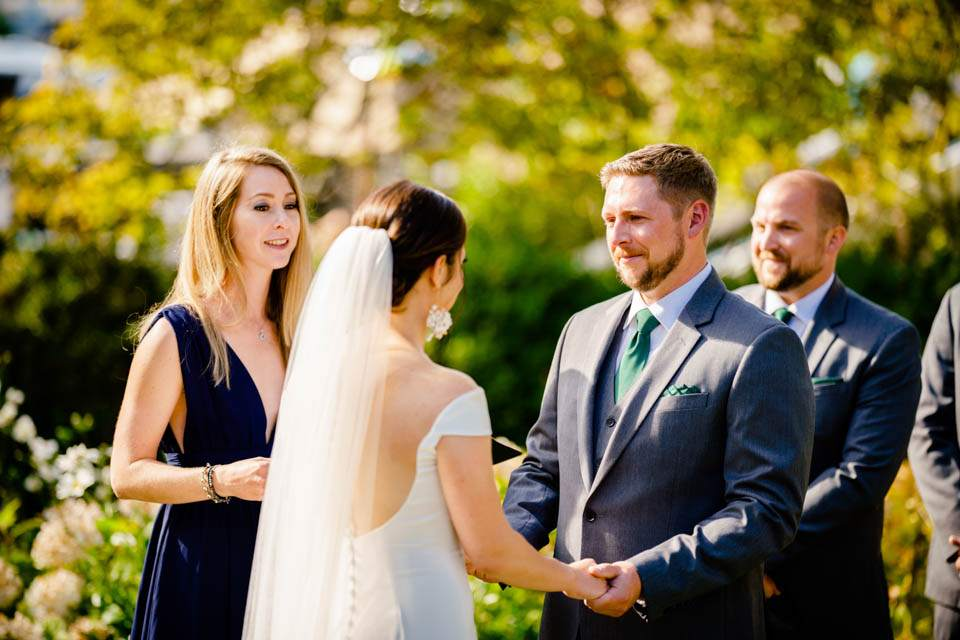 bride and groom holding hands while reciting vows
