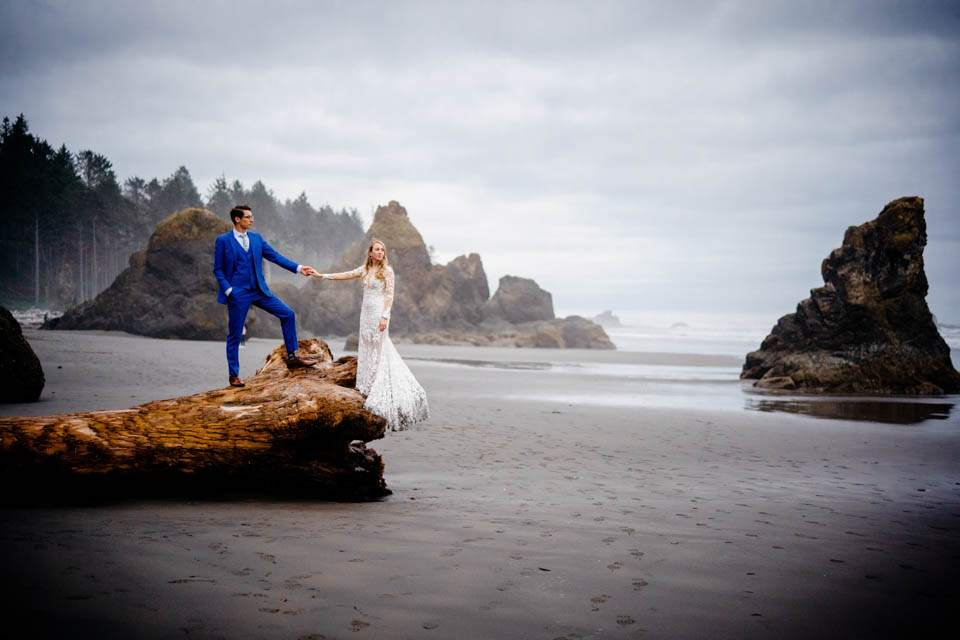 bride and groom on pacific coast beach