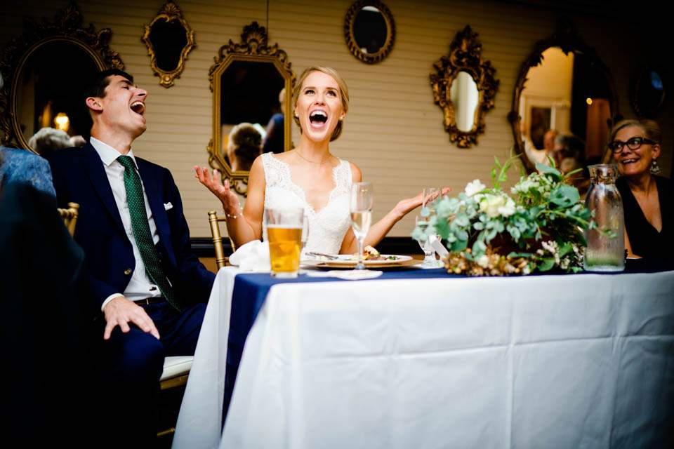bride and groom reaction to wedding toasts