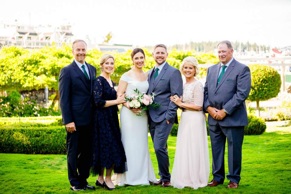bride and groom with parents at roche harbor